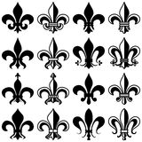 Fleur de Lys Collection. A collection of eight fleurs de lis isolated on white background. Each fleur de lys (or fleur de lis) is drawn in two versions (all Royalty Free Stock Photo