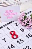 Fleur et calendrier sur le bois Images libres de droits