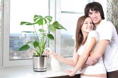 Fleur et fille avec le garçon Photos stock