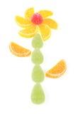 Fleur faite par des morceaux de confiture d'oranges  Images libres de droits