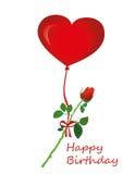 Fleur rose accrochant sur un ruban rouge avec un arc sur une boule d'air chaud Photographie stock libre de droits