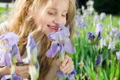 Fleur sentante de petite fille Images libres de droits