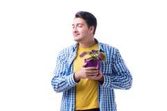 Fleuriste de jardinier avec une fleur dans un pot d'isolement sur le backgr blanc Photographie stock