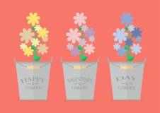 Fleurs dans des pots avec la Saint-Valentin heureuse de mot Photos stock