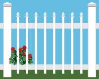 Fleurs dans la barrière Photo stock