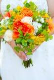 Fleurs de bouquet de jeune mariée Image libre de droits