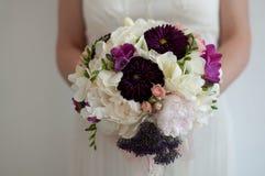 Fleurs de robe de mariage Photographie stock