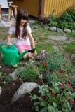 Fleurs et fille Images stock