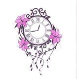 Fleurs et horloge de lis Photo stock
