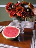 Fleurs et melon Image stock
