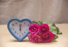 Fleurs et temps avec amour Photo stock