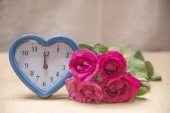 Fleurs et temps avec amour Photos stock