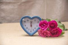 Fleurs et temps avec amour Photographie stock