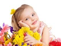 Fleurs heureuses de fixation d'enfant. Photo stock