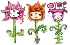 Fleurs mignonnes avec les visages drôles Image stock