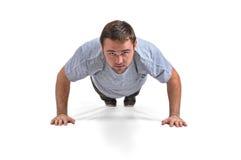 Flexões de braço do desportista Imagens de Stock