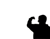Flex. Silhouette of a man flexing his arm muscle Stock Photo
