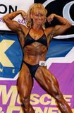 Flex Appeal. Stunning amateur woman bodybuilder Gina Hall won her pro card by taking first place in the heavyweight class of the NPC (National Physique Committee Stock Photos