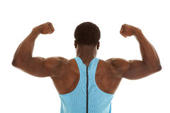 Flex back up close. A back view of a man flexing showing off his muscles Stock Photography