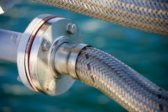 Flex joint. Flex/Expansion fitting in the plumbing of a marina Stock Photography