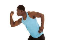 Flex look to side. A man showing off his muscles by flexing his arm Royalty Free Stock Photography