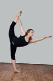 Flexibility. Young woman demonstrates her flexibility in an advanced yoga class Royalty Free Stock Photos