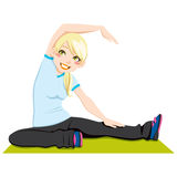 Flexibility Workout. Gorgeous blond girl exercising flexibility with stretching posture Stock Photo