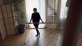 Flexible mature woman practicing at home. Elegant slim woman in black clothes doing exercises indoors. Happy life. Flexible adult woman practicing at home stock video footage