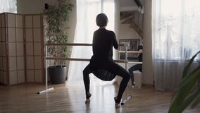 Flexible adult woman practicing at home. Elegant slim woman in black clothes doing exercises indoors. Happy life. Keeping in shape stock video