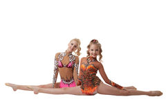 Flexible artistic gymnasts posing at camera Royalty Free Stock Image