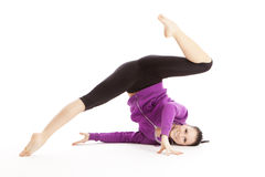 Athletic woman doing gymnastic Stock Photo