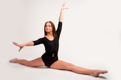 Flexible athletic woman Stock Photos