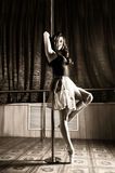 Flexible ballet dancer stretching in retro style. Ballerina dances near pole Stock Photo