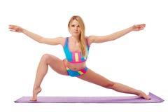 Flexible blonde warming up looking at camera Royalty Free Stock Image