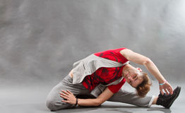 Flexible Breakdancer. Performing a dance move on the floor stock photography