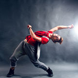Flexible Breakdancer. Performing a dance move on the floor royalty free stock images