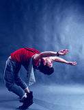 Flexible Breakdancer. Performing a dance move on the floor royalty free stock photos