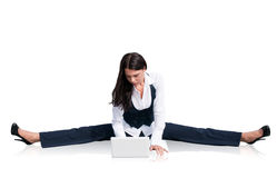 Flexible business woman with laptop Stock Photography