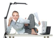 Flexible business woman talk by phone. Sitting in crooked pose and doing several things stock photography