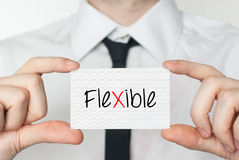 Flexible. Businessman holding business card Royalty Free Stock Photography