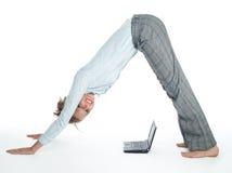 Flexible businesswoman with laptop stock photo