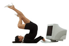 Flexible businesswoman with laptop Royalty Free Stock Photos