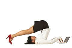 Flexible businesswoman with laptop Royalty Free Stock Images