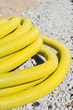 Flexible corrugated plastic pipe on the construction site. Flexible corrugated plastic pipe on the road construction site Stock Photography