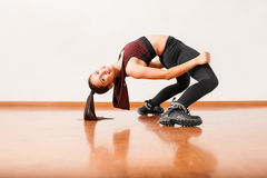 Flexible dancer bending backwards Royalty Free Stock Images