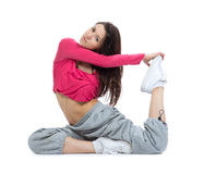 Flexible dancer doing stretching exercise. Pretty flexible dancer woman doing stretching exercise on a white background Royalty Free Stock Photos