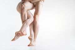 Flexible dancers legs performing in the white colored room stock photo