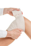 Flexible elastic supportive orthopedic bandage, compression stabilizer knee. Royalty Free Stock Photo