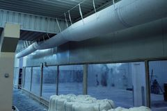 Flexible, fabric, pvc, ductwork,,ventilation,industrial, duct. Flexible fabric or pvc like DuctSox ductwork installed in the clean facility. Instant dles stock photo
