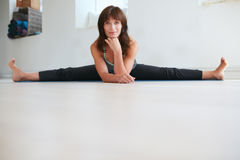 Flexible female yoga trainer Stock Photos